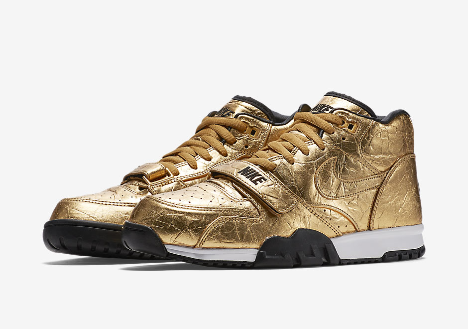 gold nike trainers